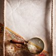 Magnifying glass on old parchment. - Stok fotoğraf