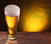 Beer glass on a wooden table. — Stock Photo