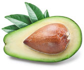 Slice of avocado with leaves. — Stock Photo