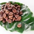 Coffee beans on leaf. — Stok fotoğraf