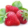 Three ripe strawberries with leaves. — Stock Photo #27383481