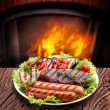 Stock Photo: Steak, sausage and vegetable on a plate