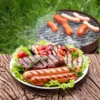 Stock Photo: Steak, sausage and vegetable