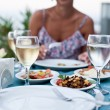 Romantic dinner with white wine. — Stock Photo