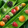 Stock Photo: Creative pewith different fruits instead grains of pea.