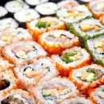 Variety of japanese sushi rolls. — Stock Photo