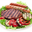 Stock Photo: Grilled steak,sausages and vegetables.