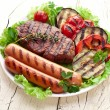 Grilled steak,sausages and vegetables. — Stok fotoğraf