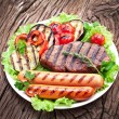 Grilled steak,sausages and vegetables. — Stock Photo #32809875