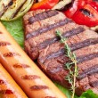 Grilled steak,sausages and vegetables. — Stock Photo