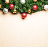 Christmas decoration with fir and baubles. — Stock fotografie