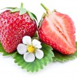 Strawberry fruit with slice and flower. — Stock Photo