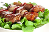 Grilled kebab (shashlik) on spits. — Stock Photo
