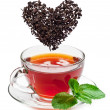 Cup of tea and tea leaves. — Stock Photo