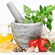 Mortar with pestle and basil herbs and olive oil. — Stock Photo