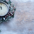 Christmas clock over snow wooden background. — Zdjęcie stockowe
