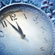 New Year clock powdered with snow. — Stock fotografie