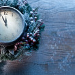 Christmas clock over snow wooden background. — Stock Photo #36981885
