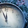 New Year clock powdered with snow. — Stok fotoğraf