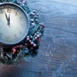 Christmas clock over snow wooden background. — Stock Photo #36981911