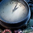 Stock Photo: New Year clock powdered with snow.