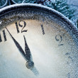 New Year clock powdered with snow. — Stock Photo #36981919
