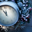 Christmas clock over snow wooden background. — Stock Photo #36981965