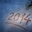 New Year 2014 on snow-covered wooden desk. — Stock Photo