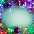 Christmas frame with baubles, snow and fairy lights. — Stock Photo #36982379