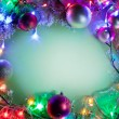 Christmas frame with baubles, snow and fairy lights. — Stock Photo