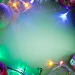 Christmas frame with fairy lights and baubles. — Stock Photo #36982381