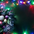 Christmas decoration with fir and baubles and fairy lights. — Stock Photo #36982421