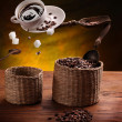 Cup of coffee, a sugar and coffee beans in the air . — Stock Photo #36983867