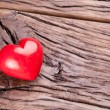 Stock Photo: Valentines Day. Red heart on a wooden table.