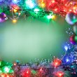 Christmas frame with fairy lights and baubles. — Stock Photo #36984527