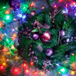 Christmas decoration with fir and baubles and fairy lights. — Stock Photo #36984571
