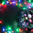 Christmas decoration with fir and baubles and fairy lights. — Stock Photo #36984605