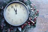 Christmas clock over snow wooden background. — Stock Photo