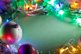 Christmas decoration with fairy lights and baubles. — Foto de Stock
