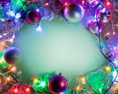 Christmas frame with baubles, snow and fairy lights. — Стоковое фото