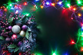 Christmas decoration with fir and baubles and fairy lights. — Стоковое фото