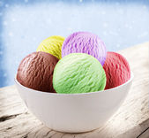 Colorful ice-cream scoops in white cones. — Stock Photo
