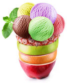 Ice-cream scoops in fruity glass. — Stock Photo