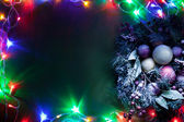 Christmas decoration with fir and baubles and fairy lights. — Stock fotografie