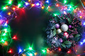 Christmas decoration with fir and baubles and fairy lights. — Stockfoto