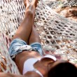 Stock Photo: Young woman in hammock.