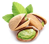 Pistachio nuts with leaves. — Stock Photo