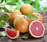 Grapefruits on a wooden table. — Stock Photo