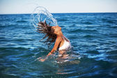 Woman splashing water with her hair. — Стоковое фото