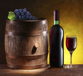 Still life with wine barrel, bottle and glass. — Stock Photo